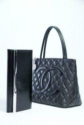 Michael Kors Clutch and Chanel Handbag. Jan. 3, 2013