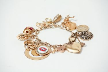 Gold charm braclet. May 16, 2013